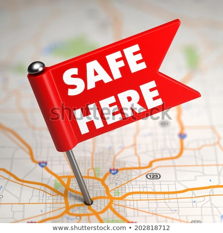 Safe Here - Small Flag on a Map Background with. Stock photo © tashatuvango