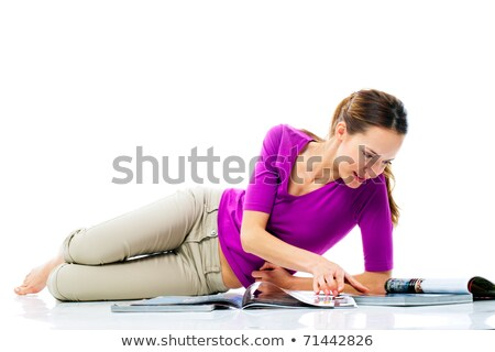 woman sitting on the floor reading a magazine stock photo © ambro