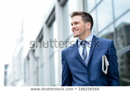 handsome businessman posing at outdoor stock photo © stockyimages