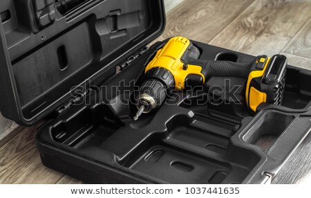 Battery screwdriver on wooden floor Stock photo © HASLOO