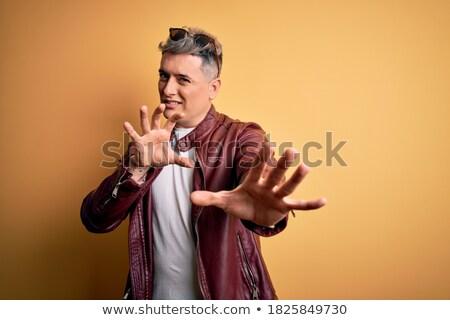 Férfi bőrdzseki napszemüveg kiabál jóképű férfi mosoly Stock fotó © feelphotoart