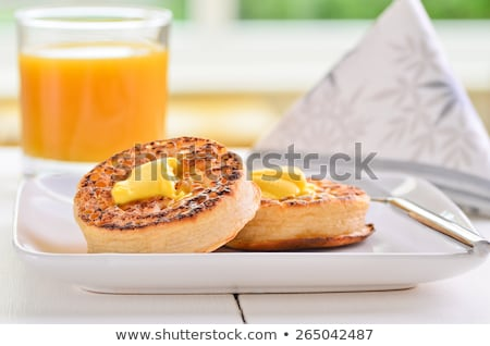 Toasted crumpets with melted butter Stock photo © raphotos