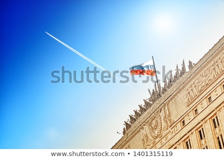Jet airliner against aerial view of city Stock photo © cherezoff