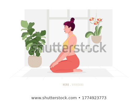 girl sitting in yoga pose virasana   hero pose stock photo © orensila