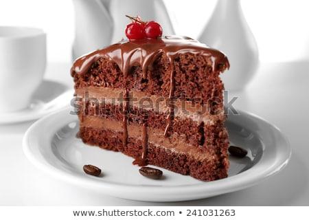 Stuk cake plaat zwarte koffie houten koffie Stockfoto © OleksandrO