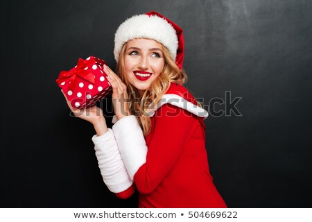 Mrs Santa Claus Holding A Present For Christmas Stock photo © LironPeer