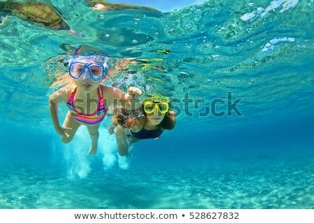 Kislány snorkeling úszómedence lány gyermek nyár Stock fotó © phbcz