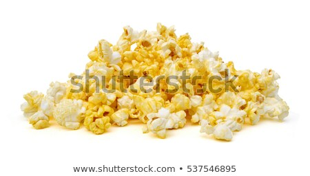 salted popcorn grains on the white background stock photo © ozaiachin