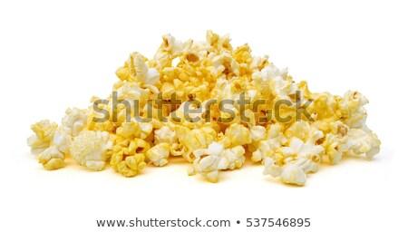 Salted popcorn grains on the white background Stock photo © ozaiachin