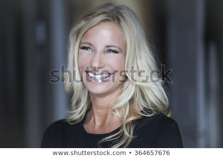 elegant blonde woman looking away from the camera stock photo © feedough