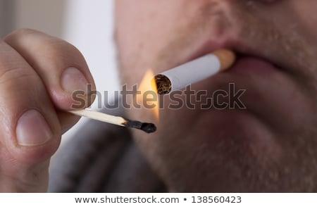 casual · homem · iluminação · cigarro · jovem · moda - foto stock © stevanovicigor
