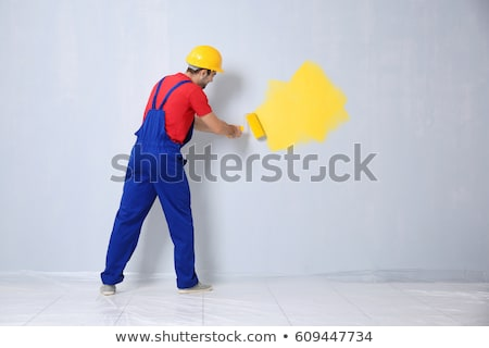 Stock photo: Young man painting on wall