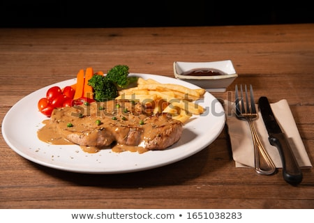 Grilled steak with french fries and broccoli  Stock photo © fanfo