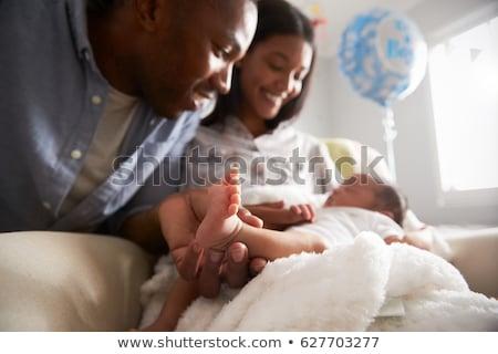 újszülött · baba · alszik · szülők · kéz · gyermek - stock fotó © len44ik