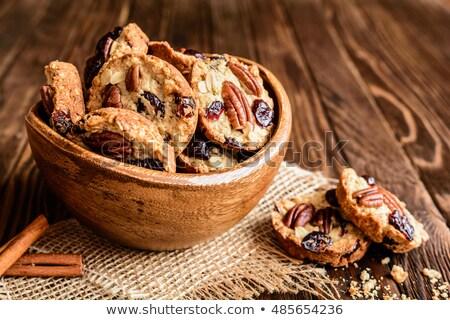 dish with sweet fruit and cookies Stock photo © artfotoss