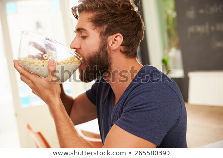 young man is hungry stock photo © filipw