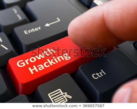 Press Button Growth Hacking on Black Keyboard. Stock photo © tashatuvango