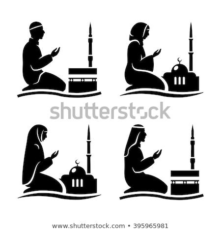 Silhouette of a Muslim praying man  Stock photo © shawlinmohd