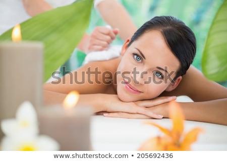 bastante · morena · massagem · câmera - foto stock © wavebreak_media