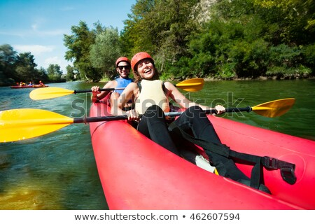 каноэ рафтинга реке весело счастливым мужчины Сток-фото © vilevi