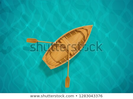 Wooden boat with paddles for fishing Stock photo © LoopAll