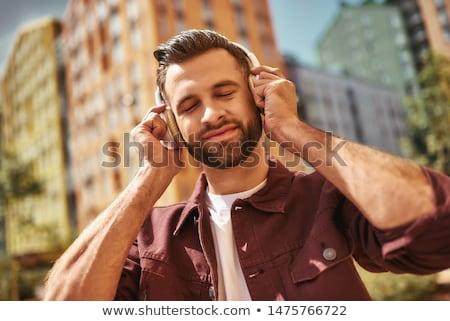 adult man listening to music on headphones eyes closed stock photo © stevanovicigor