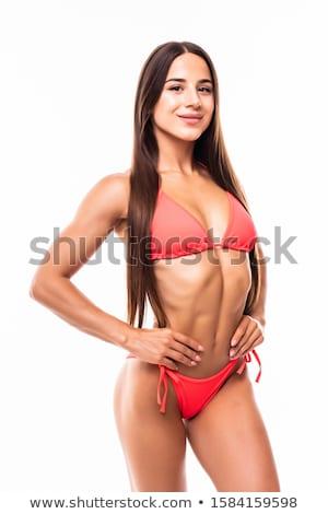 Beautiful curvaceous brunette woman posing in a bikini  Stock photo © restyler