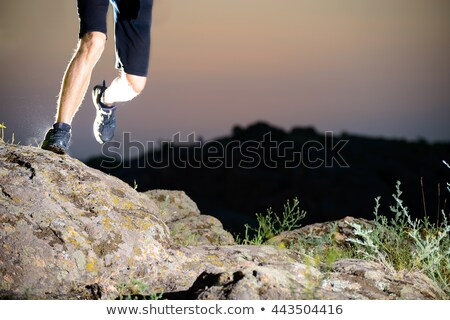 Close-up of Sportsman's Legs Running on the Rocky Mountain Trail at Night. Active Lifestyle Stock photo © maxpro