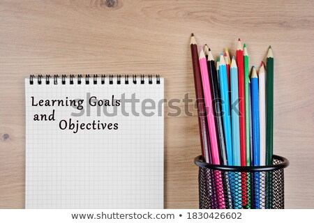 Objectives word and office tools on wooden table Stock photo © fuzzbones0