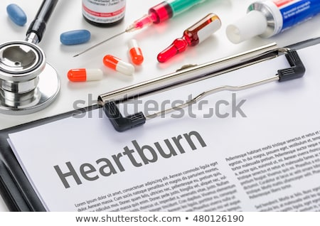 The diagnosis Heartburn written on a clipboard Stock photo © Zerbor
