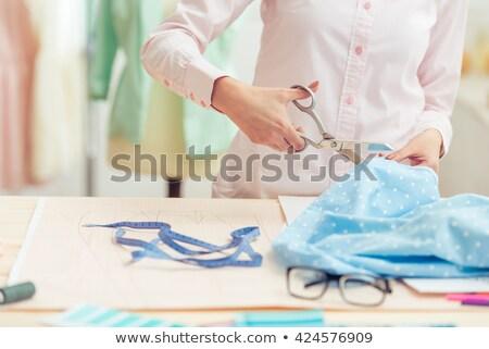 Crop female cutting fabric Stock photo © dash