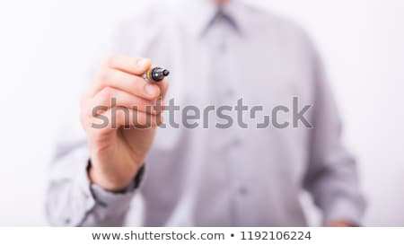 businessman writing on a glass surface stock photo © gravityimaging