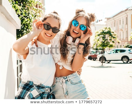 sexy woman posing in white shirt stock photo © konradbak