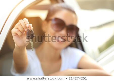 Beautiful young smiling happy girl shows the car key in her hand Stock photo © Nobilior
