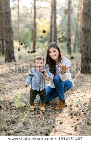 улыбаясь девушки глядя соснового конус лес Сток-фото © wavebreak_media