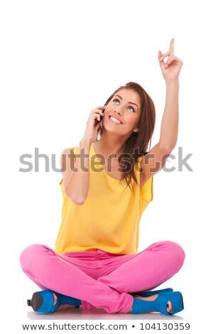 ülő lezser nő beszél telefon bemutat Stock fotó © feedough
