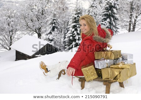 young blonde woman sitting on wooden box is laughing stock photo © feedough