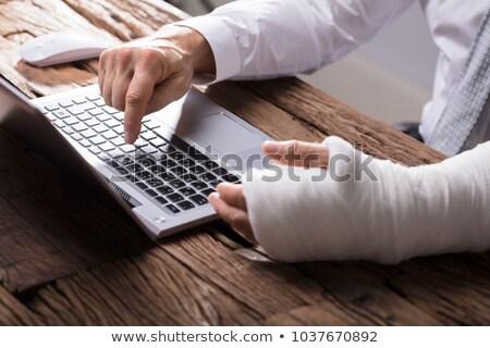 Yaralı işadamı kırık kol kafkas Stok fotoğraf © RAStudio