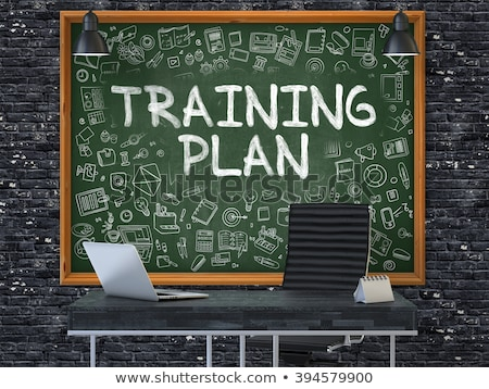 hand drawn training plan on office chalkboard stock photo © tashatuvango