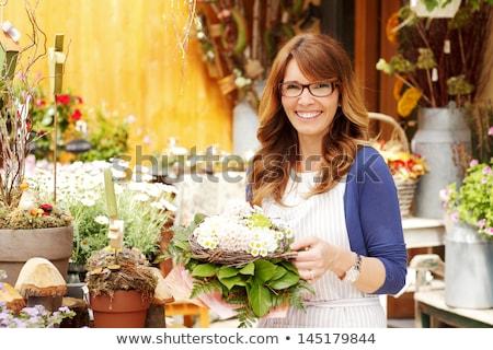 zakenvrouw · vaas · plant · portret · jonge - stockfoto © is2