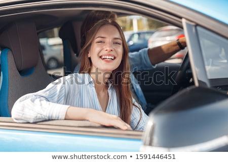 Homme regarder sur voiture électrique fenêtre voiture Photo stock © IS2