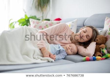 Boy playing with his mother on the bed Stock photo © IS2