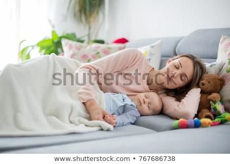 Fiú játszik anya ágy nő család Stock fotó © IS2