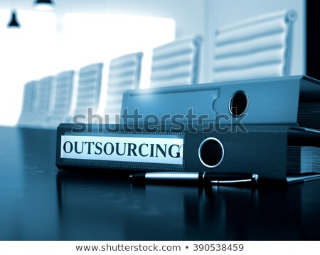 Outsourcing on Blue Ring Binder. Blurred, Toned Image. Stock photo © tashatuvango