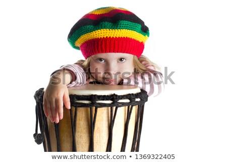 Beautiful young blonde girl in rastafarian hat Stock photo © Massonforstock