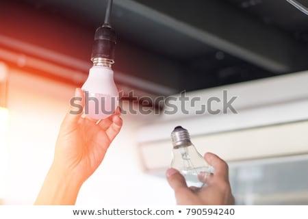 Kompakt fluoreszkáló lámpa villanykörte fa asztal technológia Stock fotó © wavebreak_media