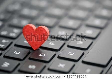 symbol of a red heart on the keyboard as a dating symbol Stock photo © mizar_21984