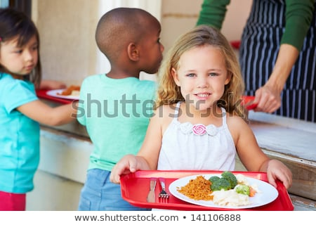A student collecting lunch from the school cafeteria Stock photo © monkey_business