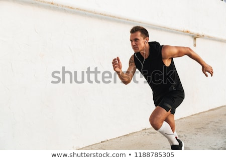 Back view of young sportsman running at the beach Stock photo © deandrobot