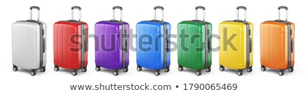 Bright Red Suitcase on Wheels to Travel Abroad Stock photo © robuart